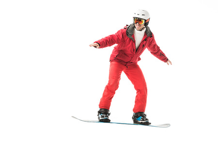 adult man in red ski suit snowboarding isolated on white Stock Photo