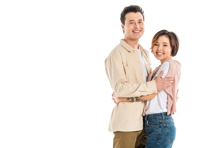 loving couple smiling, hugging and looking at camera isolated on white