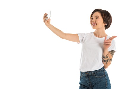 happy young woman taking selfie on smartphone isolated on white Stok Fotoğraf