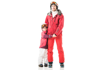Dad and daughter holding hands and standing in snowsuits isolated on white Stock Photo