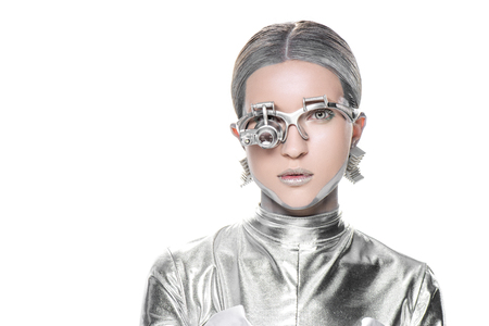 portrait of silver robot with eye prosthesis looking at camera isolated on white, future technology concept Foto de archivo