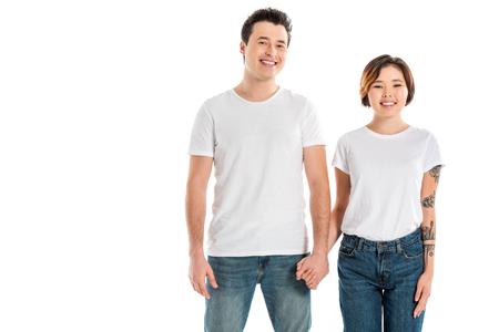 boyfriend and girlfriend holding hands and looking at camera isolated on white Stok Fotoğraf