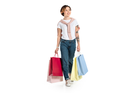 smiling young woman holding shopping bags isolated on white Stok Fotoğraf
