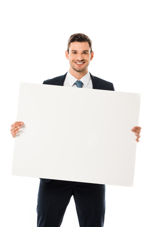 smiling businessman in suit showing blank poster with copy space isolated on white Stock Photo