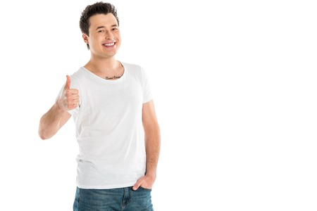 handsome smiling man showing thumbs up sign and looking at camera isolated on white Stok Fotoğraf