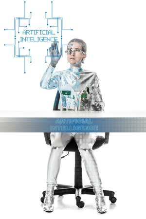cyborg sitting at table and touching artificial intelligence lettering in digital data isolated on white, future technology concept