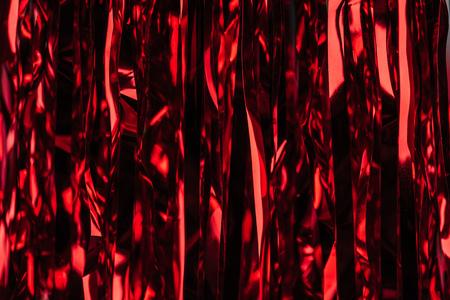 celebration red shiny serpentine as christmas background