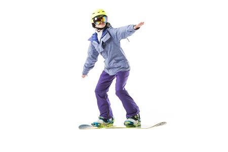 adult woman in ski clothes snowboarding isolated on white