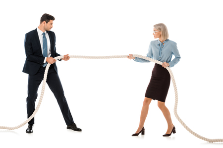 businesspeople in formal wear playing tug of war isolated on white