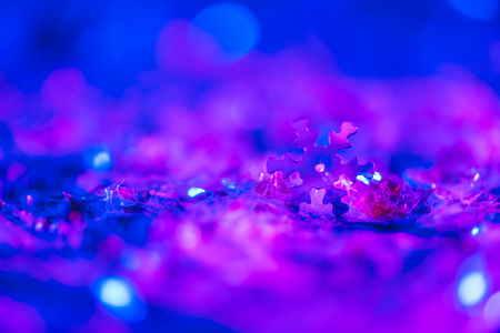 christmas background with glowing ultra violet glitter and decorative snowflake