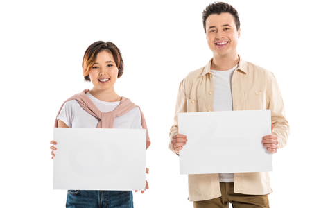 smiling husband and wife in casual clothes looking at camera and holding two blank boards isolated on white Stok Fotoğraf