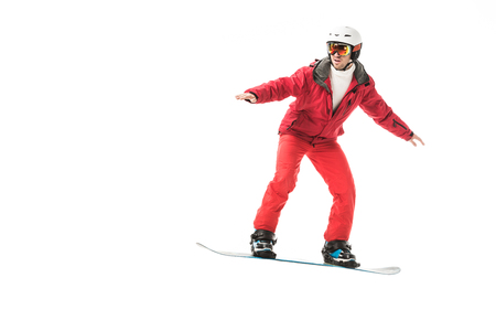 adult man in ski clothes snowboarding isolated on white