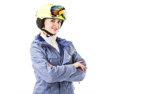 Pretty woman in blue ski jacket, goggles and helmet smiling and looking at camera isolated on white Reklamní fotografie
