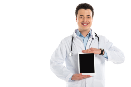 smiling male doctor presenting digital tablet with blank screen isolated on white