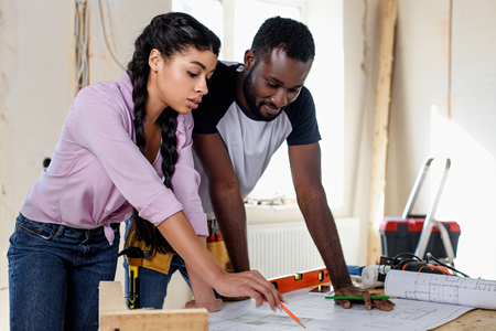 couple looking at architecture plan while making renovation of home Stockfoto