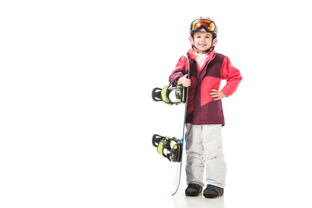 Cute preschooler child with snowboard equipment smiling and looking at camera isolated on white