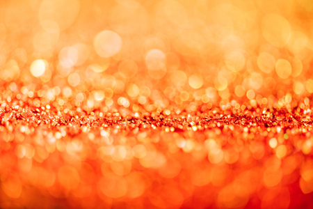 abstract christmas background with orange glitter and bokeh Stock Photo
