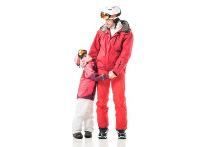 Father and daughter holding hands and standing in snowsuits isolated on white