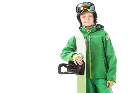 preteen boy in snowsuit with snowboard smiling and looking at camera isolated on white Stock Photo