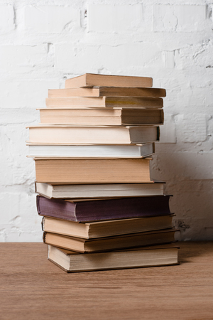 close-up view of pile of books on wooden table 写真素材