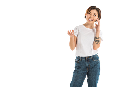 happy young woman talking on smartphone isolated on white