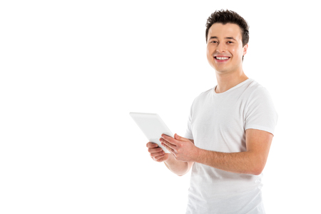handsome man using digital tablet and looking at camera isolated on white Stok Fotoğraf