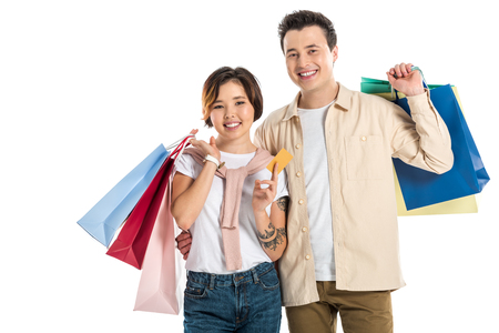 happy couple holding shopping bags and credit card isolated on white Stok Fotoğraf