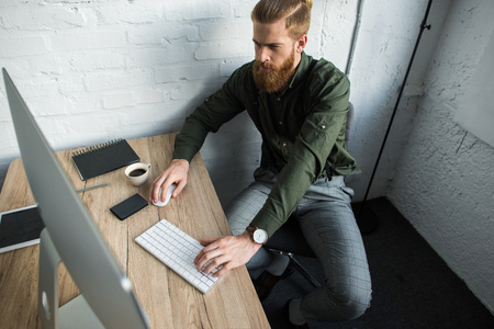 high angle view of businessman working at computer in office Stock Photo
