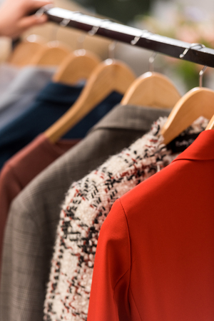 close up view of fashionable clothes on hangers 写真素材 - 112551156