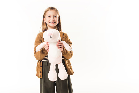 happy little child with soft toy bunny isolated on white Standard-Bild - 112537564