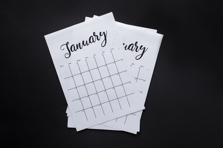 top view of arranged parts of paper calendar isolated on black Stockfoto - 112539873