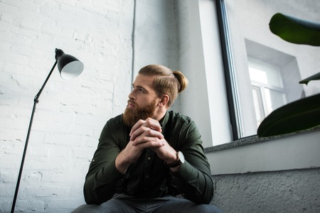 bottom view of businessman sitting and looking up Stock Photo