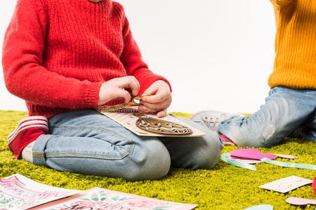 cropped shot of little child making diy greeting card