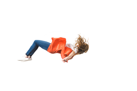 side view of girl in red mantle falling isolated on white