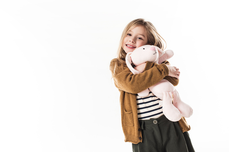 happy little child embracing with soft toy bunny isolated on white Standard-Bild - 112539709