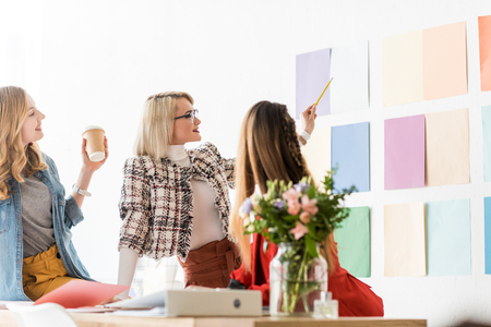fashionable magazine editors working with color palette an wall
