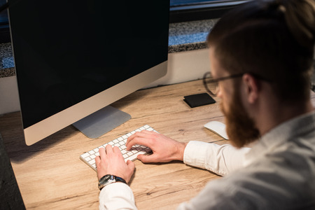businessman typing something on keyboard in office Stock Photo