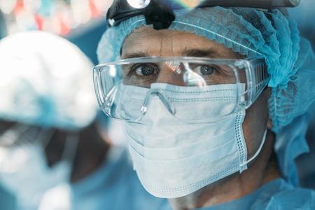 handsome surgeon in medical mask looking at camera Zdjęcie Seryjne