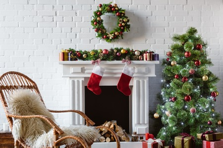 living room with fireplace, rocking chair and decorated christmas tree Reklamní fotografie
