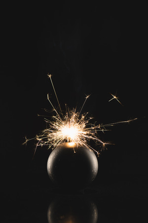 close up view of burning sparklers in christmas toy isolated on black Stock Photo - 112742627