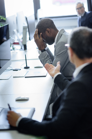 selective focus of stressed african american businessman and arguing colleague in office Stock fotó