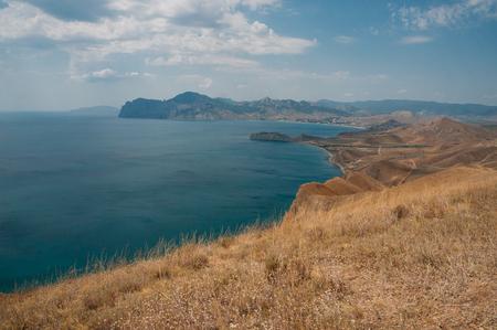 Scenic calm seashore with Crimean mountains ridge, Ukraine, May 2013
