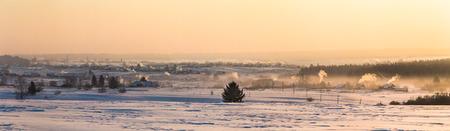 beautiful winter landscape and village at countryside at sunset, kazan region, russia Stock Photo