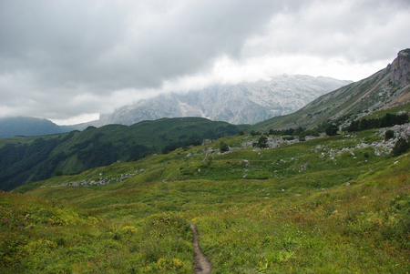 view on path and valley, Russian Federation, Caucasus, July 2012 版權商用圖片