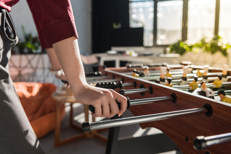 cropped shot of businesswoman playing table football at office Stock Photo