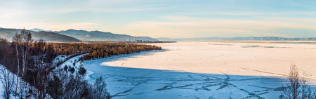 Beautiful scenic landscape with shore and frozen lake Baikal