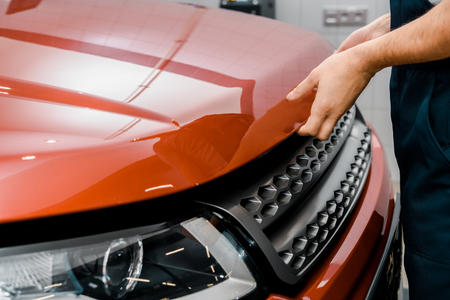 Cropped shot of auto mechanic opening car cowl for examination at mechanic shop Stock Photo - 112747651
