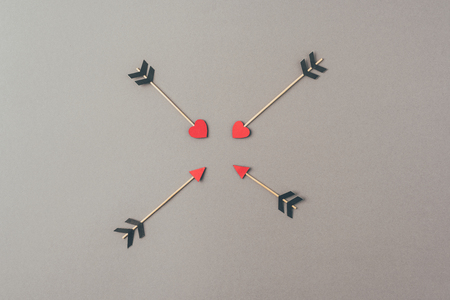 Top view of four arrows on gray surface Stok Fotoğraf - 112747780