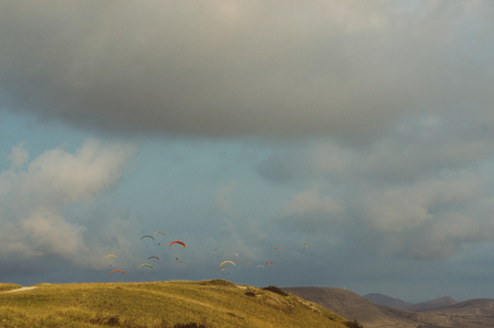 Mountainous landscape with paratroopers flying in the sky, Crimea, Ukraine. Stock Photo