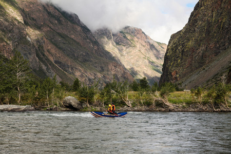 People on kayaks rafting on mountain river and beautiful landscape, Altai, Russia Stok Fotoğraf - 112748126